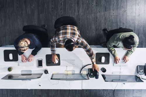 High angle shot of a group of call centre agents working in an office