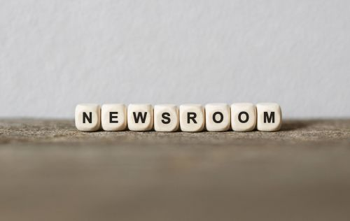 Word NEWSROOM made with wood building blocks,stock image