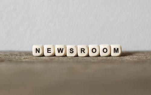 Word NEWSROOM made with wood building blocks,stock image